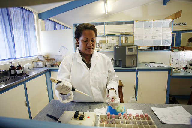 olomon Islands. Margaret Baekimia analysing a blood sample in the Pathology laboratory at the Kilu'ufi hospital. Photo: Rob Maccoll for AusAID.