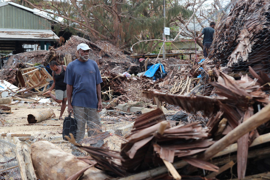 Market traders in Port Vila look through the debris left by Cyclone Pam (image: Mark Mitchell for Caritas Aotearoa New Zealand)