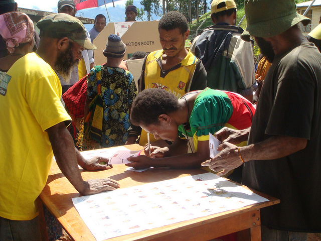 A voter marks her ballot during the 2012 elections in the PNG highlands (Flickr/Commonwealth Secretariat/Treva Braun CC BY NC ND 2.0)
