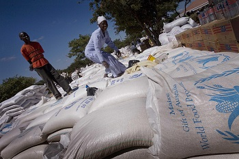 Bags of food aid donated by the Australian Gov't in Harare, Zimbabwe, 23 April 2009 (Flickr/DFAT/AusAID/Kate Holt CC BY 2.0)