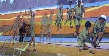 An artist prepares a patriotic mural by the road between Asmara and Keren, Eritrea (David Stanley/Flickr CC BY 2.0)
