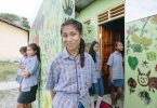 Etelvina Vita Da Costa, 15 (centre), outside the new toilet block at Ailuli Pre-Secondary School in Same, Manufahi District, Timor-Leste (WaterAid/Greenwood)