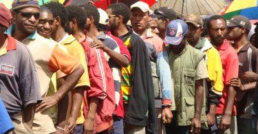Men queue to vote in 2012 (Treva Braun/Commonwealth Secretariat/Flickr CC BY-NC-ND 2.0)