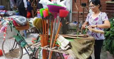 Bicycle broom seller, Hanoi (image: CARE)