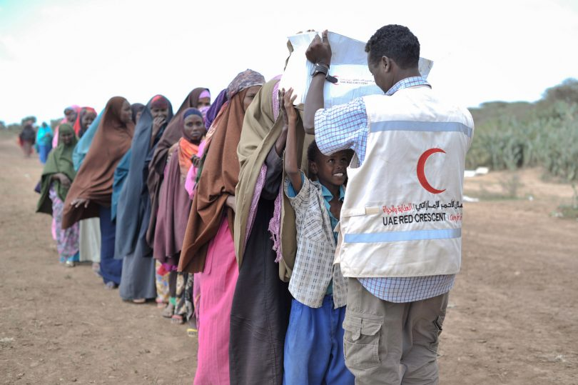 Boy receives a box of food from UAE Red Crescent in Afgoye, Somalia (AMISOM Public Information/Flickr)
