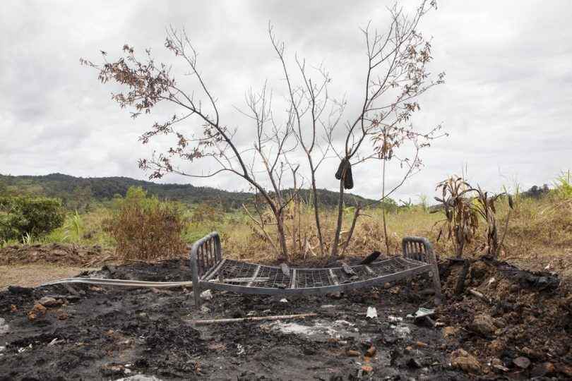 Remains of a house set alight during an attack targeting a family accused of sorcery, Southern Highlands Province (Jesse Boylan/ICRC)