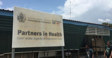 Australian aid sign at the National Referral Hospital, Honiara (Credit: Camilla Burkot)