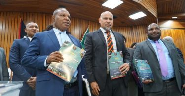 PNG Planning Minister Richard Maru and Treasurer Charles Abel during the budget lockup (ABC News: Eric Tlozek)