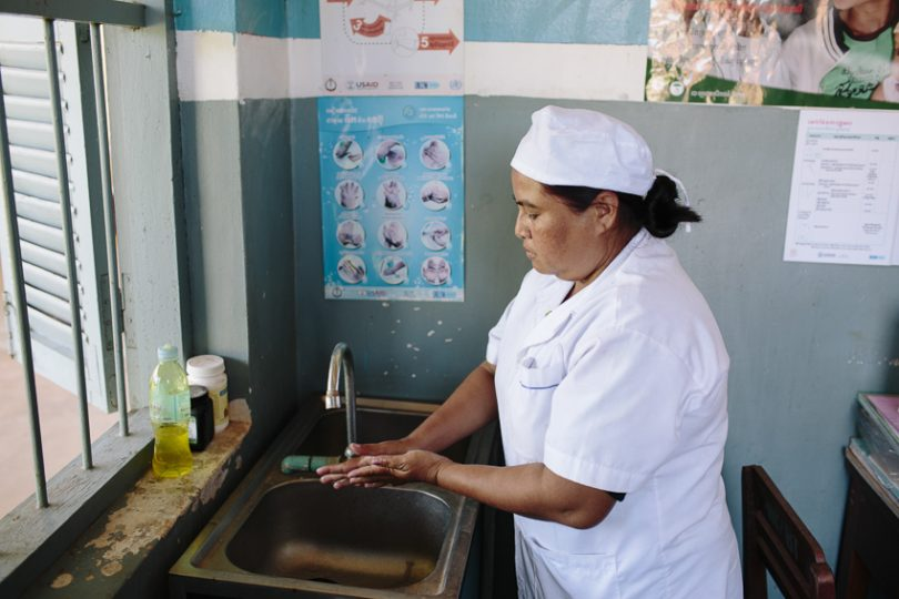 Midwife washes her hands at a sink, Cambodia (Photo credit: WaterAid/Tom Greenwood)
