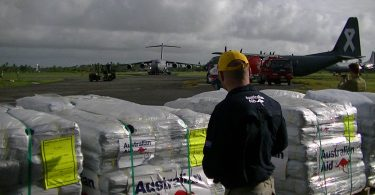 Humanitarian supplies being loaded for transport to Koro island (DFAT/Flickr/CC-BY-2.0)