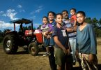 A farming family standing in front of their tractor in Nuku'alofa, Tonga (Asian Development Bank/Flickr/CC BY-NC-ND 2.0)