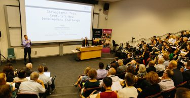 Nancy Birdsall presenting the keynote address at the 2018 Australasian Aid Conference