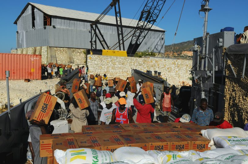 Haitian civilians unload relief supplies from a US Navy ship (Marion Doss/Flickr/CC BY-SA-2.0)
