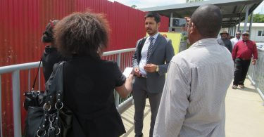 Madang MP Bryan Kramer talks to media after the hearing (Credit: Amanda H A Watson)