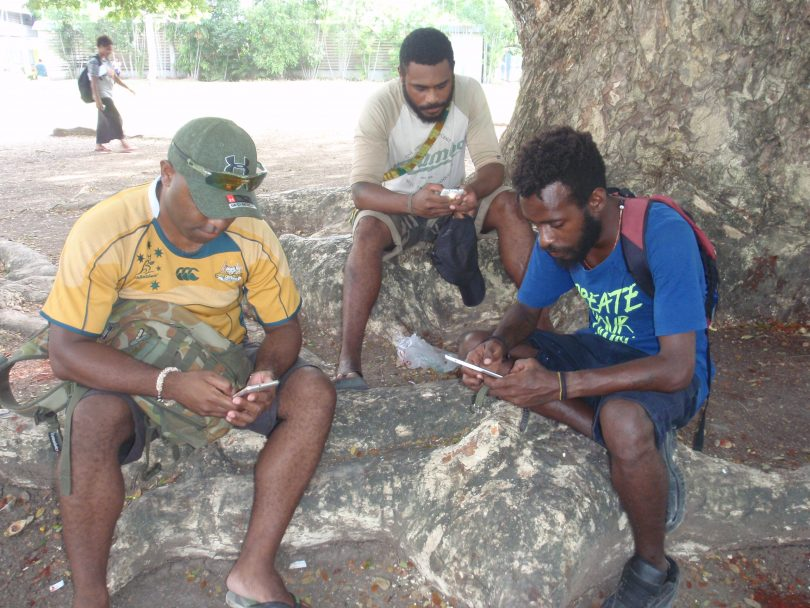 UPNG students using their mobile phones (Credit: Amanda Watson)
