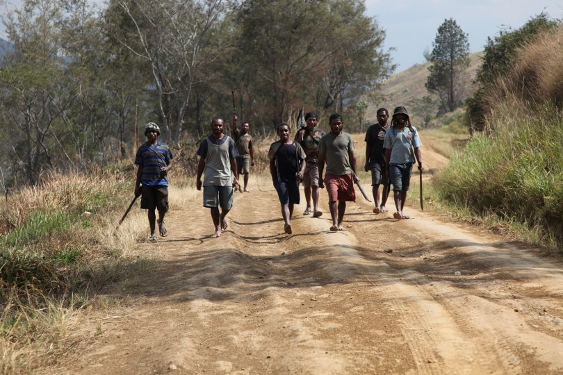 Young men in Eastern Highlands, PNG engaged in tribal conflict walking to meet the opposing tribe (DFAT/Flickr/CC BY 2.0)