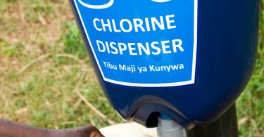 A chlorine dispenser installed as part of a randomised control trial in Kenya and Uganda (Jonathan Kalan/DIVatUSAID/Flickr/CC BY-NC-ND 2.0)