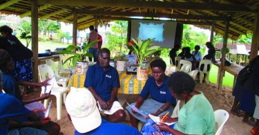 Group discussion between Local Village Health Volunteers as part of a BHCP orientation exercise in the Bana District in 2014 (Credit: BHCP)