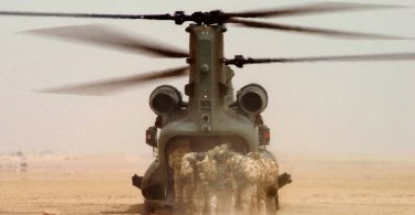 Royal marines board a helicopter (Think Defence/Flickr/CC BY-NC 2.0)
