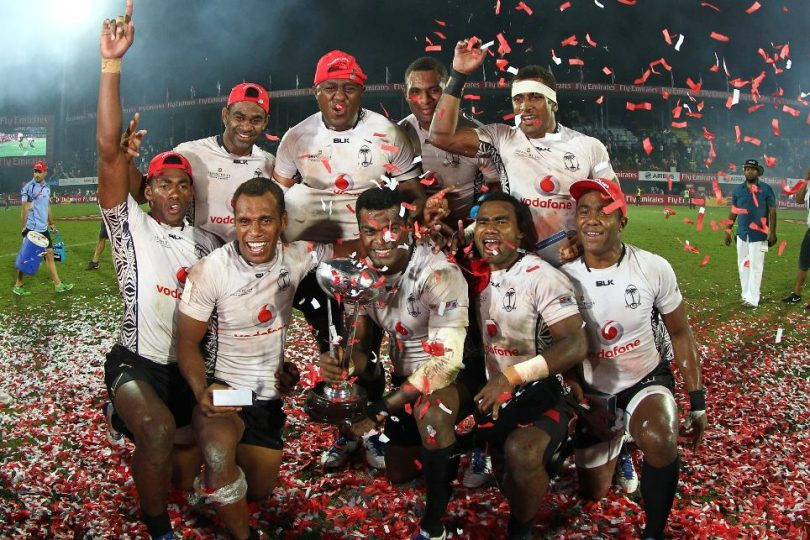 The Fiji team after winning the opening round of the HSBC World Rugby Sevens Series in 2015 (Photo credit: World Rugby)