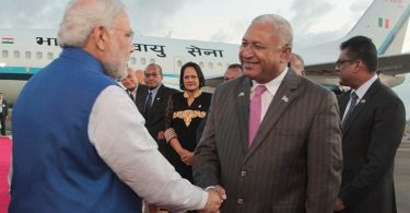 Fijian PM Bainimarama (right) greets Indian PM Modi (left) on arrival in Fiji, 2014 (Credit: Dinfo News)