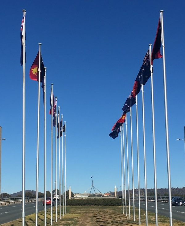 PNG flags fly at Commonwealth Bridge, Canberra (Credit: Michelle Rooney)